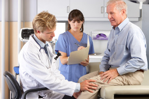 bigstock-Doctor-Examining-Male-Patient-41853490-300x200